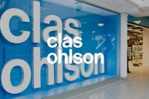Clas Ohlson shop front with overlay white text displaying brand name