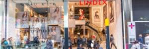 Shopping centre Lindex shop front with lots of shoppers crowding round doors and within