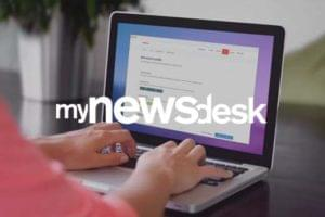 mynewsdesk logo overlayed user on mac with browser showing website