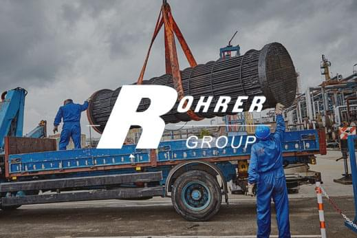 Rohrer group white logo overlayed mechanical services products being loaded onto a flat bed lorry