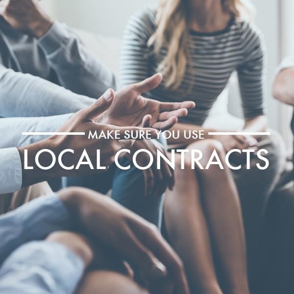 Local contracts when employing in the uk image showing a meeting of professionals