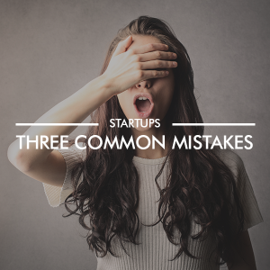 Female with hand over face and white overlay text stating three common startup mistakes